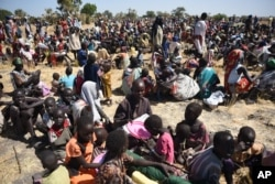 FILE - More than 30,000 people flocked to Leer town, South Sudan, to receive food from the International Committee of the Red Cross, Dec. 15, 2015.