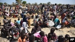 FILE - Some of more than 30,000 people who flocked into Leer town, South Sudan, to receive food from the International Committee of the Red Cross, Dec. 15, 2015, which marks the two-year anniversary of South Sudan's civil war.