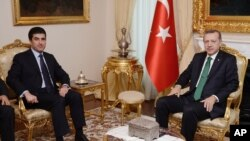 Turkish Prime Minister Recep Tayyip Erdogan, right, and Nechirvan Idris Barzani, head of Regional Government of Iraqi Kurdistan, meet in Ankara, Nov. 27, 2013.