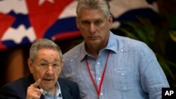 FILE - Cuba's President Raul Castro, left, gestures as he stands with Vice President Miguel Diaz Canel during the 7th Cuban Communist Party Congress in Havana, Cuba, April 16, 2016.