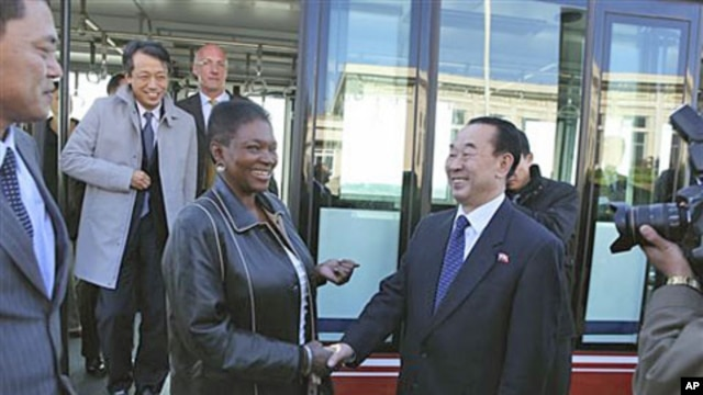 U.N. humanitarian chief Valerie Amos, center left, shakes hands with North Korean Deputy Foreign Minister Pak Kil Yon on her arrival at Pyongyang airport, October 17, 2011.