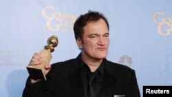 "Director Quentin Tarantino holds the award for Best Screenplay - Motion Picture for ""Django Unchained"" backstage at the 70th annual Golden Globe Awards in Beverly Hills, California, January 13, 2013."