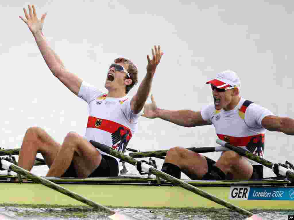 Germany's Phillipp Wende and Karl Schulze celebrate after winning the gold medal for the men's quadruple rowing sculls.