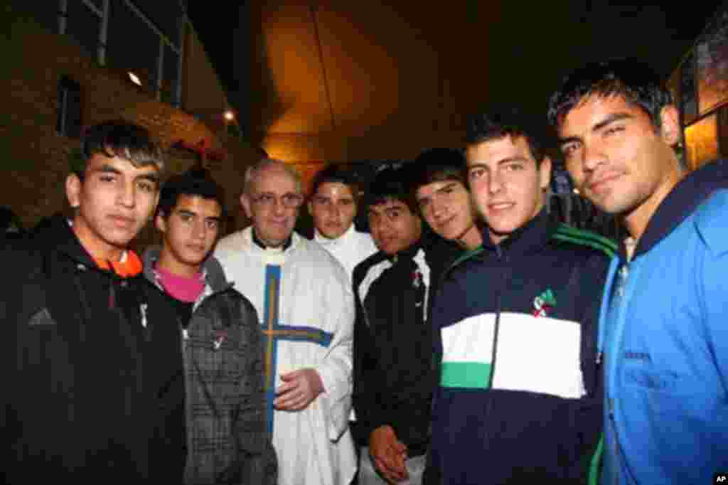 Argentina's Cardinal Jorge Bergoglio, third from left, poses with young players of the San Lorenzo soccer team inside the soccer club's chapel in Buenos Aires, March 24, 2011. Bergoglio was chosen as Pope on March 13, 2013, the first pope ever from the Americas and the first from outside Europe in more than a millenium.(AP Photo/Club Atletico San Lorenzo de Almagro)