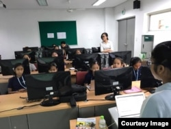 "Tes Putthira, technical mentor for coding for train the ""Cambodia Identity Product"" girls team from the Liger Learning Center during a 12-weekend training at the Cambodia-Korea Cooperation Center. (Courtesy of Technovation Cambodia)"