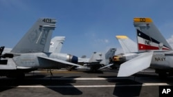 U.S. military aircraft sit on the flight deck of the USS Carl Vinson aircraft carrier anchored off Manila, Philippines, Feb. 17, 2018.