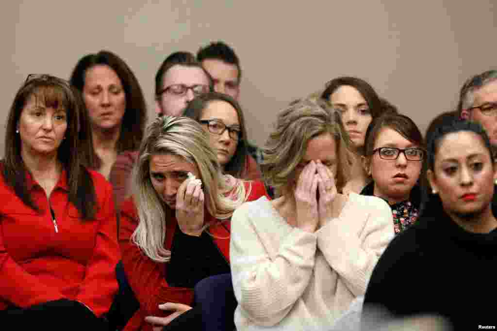Victims and others look on as Rachael Denhollander speaks at the sentencing hearing for Larry Nassar, a former team USA Gymnastics doctor who pleaded guilty in Nov. 2017, to sexual assault charges, in Lansing, Michigan.