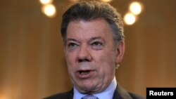 FILE - Colombia's President Juan Manuel Santos speaks during a Reuters interview at the presidential palace in Bogota, April 7, 2015.