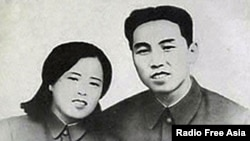 Kim Jong Sook (L) is shown with North Korea's first leader Kim Il Sung in a file photo.