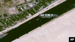 This satellite image from Cnes2021, Distribution Airbus DS, shows the cargo ship MV Ever Given stuck in the Suez Canal near Suez, Egypt, Thursday, March 25, 2021.