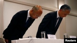 McDonald's Holdings Company Ltd. Senior Vice President Takehiko Aoki, right, and McDonald's Company Ltd. Senior Vice President Hidehito Hishinuma bow at the end of a news conference in Tokyo, Jan. 7, 2015.