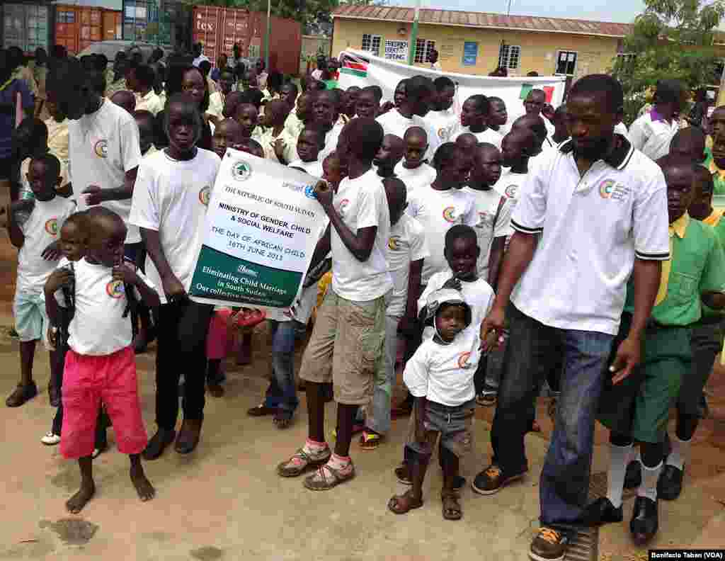 Children march at the Nyakuron Cultural Center in Juba to mark the Day of the African Child.