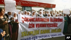 Kurdish women demonstrate near a prison in Sincan, on the outskirts of Ankara, Turkey, Friday, Nov. 2, 2012.