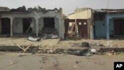 Des dégats causés par un attentat contre un immeuble à Damaturu, Nigeria, 18 juin 2014