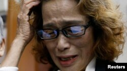 FILE - Junko Ishido, mother of Japanese journalist Kenji Goto who was slain by Islamic State militants, speaks to reporters at her house in Tokyo, Feb. 1, 2015.