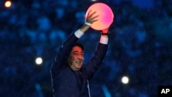 Rio Olympics Closing Ceremony: Japan's Prime Minister Shinzo Abe appears during the closing ceremony in the Maracana stadium at the 2016 Summer Olympics in Rio de Janeiro, Brazil, Sunday, Aug. 21, 2016.