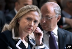"FILE - U.S. Secretary of State Hillary Clinton and French Foreign Minister Laurent Fabius attend the ""Friends of Syria"" conference in Paris, July 6, 2012."