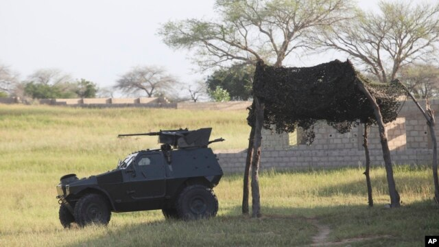 FILE - An armored vehicle is seen parked near the joint anti-Boko Haram task force headquarters in Maiduguri, Nigeria, Sept. 26, 2011. The radical sect is the gravest security threat to Africa's most populous nation.