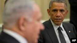FILE - President Barack Obama listens as Israeli Prime Minister Benjamin Netanyahu speaks during their meeting in the Oval Office of the White House in Washington, Oct. 1, 2014.