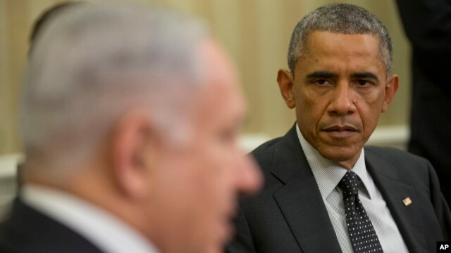FILE - President Barack Obama listens as Israeli Prime Minister Benjamin Netanyahu speaks during their meeting in the Oval Office of the White House in Washington, Oct. 1, 2014.