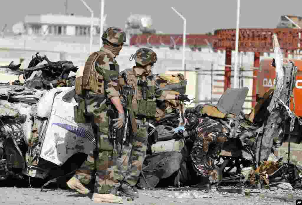 French soldiers arrive at the scene of a suicide bombing, Kabul, Afghanistan, September 18, 2012.