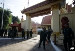 Security personnel guard the Supreme Court during its hearing to dissolve the country's main opposition Cambodia National Rescue Party in Phnom Penh, Cambodia, Nov. 16, 2017. (AP Photo/Heng Sinith)