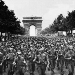 US soldiers of Pennsylvania's 28th Infantry Division march along the Champs-Elysees in Paris after the city's liberation