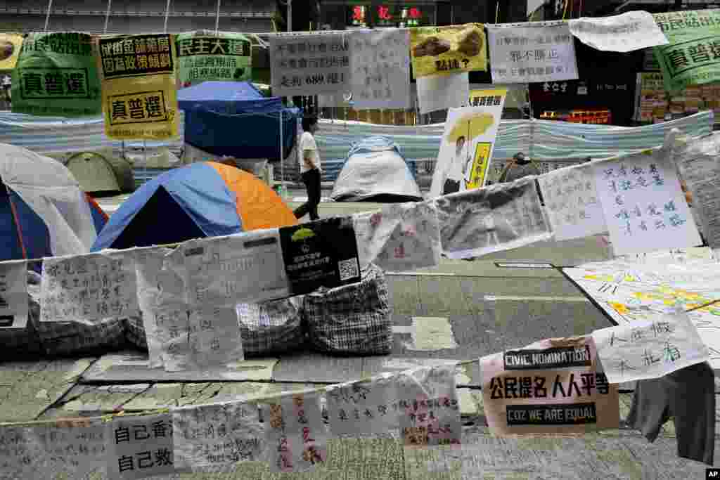 A pro-democracy protester walks in the occupied area of the Causeway Bay district in Hong Kong, Nov. 5, 2014.