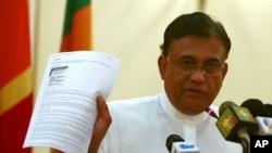 斯里兰卡外交部长5月31日手持联合国报告