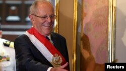 FILE - Peru's President Pedro Pablo Kuczynski attends the swearing-in ceremony of new Interior Minister Vicente Romero at the government palace in Lima, Peru, Dec. 27, 2017.