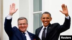 AQSh prezidenti Barak Obama Varshavada Polsha prezidenti Bronislav Komorovskiyning (chapda) mehmoni, 3 iyun, 2014-yil