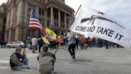 Gun rights supporters gather at a Guns Across America rally at the Texas state capitol, January 19, 2013, in Austin, Texas.