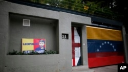 A banner with the image of opposition leader Leopoldo Lopez stands outside of his home in Caracas, Venezuela, Aug. 1, 2017.