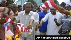 A group of Kenyan muslims burn the U.S. flag following afternoon prayers outside the Sakina Jamia Mosque in the port city of Mombasa, Sept. 14, 2012.