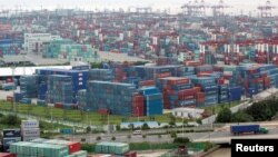 FILE - A container port in Shanghai, Aug. 11, 2009. China's trade surplus with the United States rose in June, but analysts are expecting a less favorable trade balance for China in the coming months.
