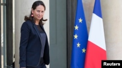 French Minister for Ecology, Sustainable Development and Energy Segolene Royal leaves following the weekly cabinet meeting at the Elysee Palace in Paris, Oct. 1, 2014.