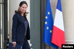 FILE - French Minister for Ecology, Sustainable Development and Energy Segolene Royal leaves following the weekly cabinet meeting at the Elysee Palace in Paris, Oct. 1, 2014.