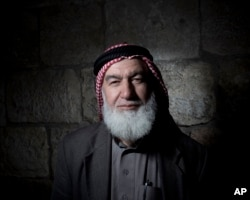 Ebrahim Hamada poses for a portrait in Jerusalem's Old City, Feb. 11, 2018.