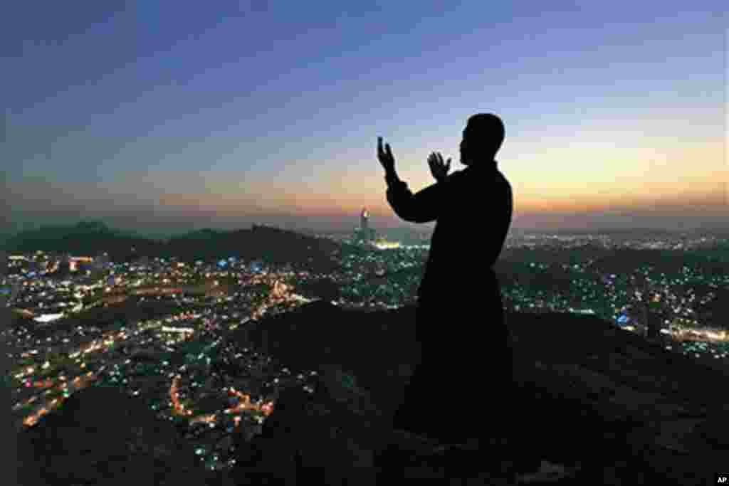 A Muslim pilgrim prays at the top of Noor Mountain near where the Hiraa cave is located, on the outskirts of Mecca, Saudi Arabia, Thursday, Nov. 11, 2010. The annual Islamic pilgrimage draws three million visitors each year, making it the largest yearly g