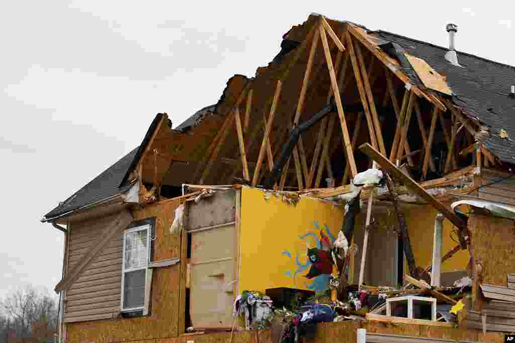A bedroom is seen after a tornado ripped the roof and walls off from a home in Charlotte, North Carolina, March 3, 2012. (Reuters)