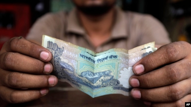 The Indian rupee recently lost nearly 20 percent of its value, a move that could further slow growth in Asia's third largest economy, September 2013.