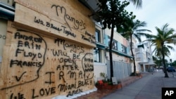 A building is boarded up on normally bustling South Beach in Miami Beach, Fla., Sept. 8, 2017. The first hurricane warnings were issued for parts of southern Florida as the state braced for what could be a catastrophic hit over the weekend.