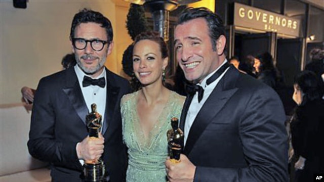 From left, Michel Hazanavicius with the award for best director for 'The Artist,' Berenice Bejo and Jean Dujardin with the award for best actor in a leading role for 'The Artist' at the Governors Ball following the 84th Academy Awards, in the Hollywood se