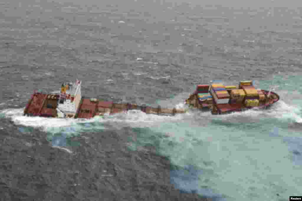 The stricken container ship Rena sits on a reef after it separated into two after being battered by waves the previous night, about 14 nautical miles (22 km) from Tauranga, on the east coast of New Zealand's North Island January 8, 2012.