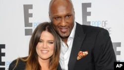 "FILE - TV personality Khloe Kardashian Odom and professional basketball player Lamar Odom from the show ""Keeping Up With The Kardashians"" at an E! Network upfront event in New York, April 30, 2015."