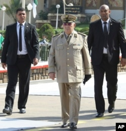"Algerian chief of staff Gen. Ahmed Gaid Salah arrives to preside a military parade at the Cherchell ""Houari Boumediene"" in Algiers, July 1, 2018."