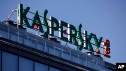 FILE - A sign is seen above the headquarters of Kaspersky Lab in Moscow, Russia, Jan. 30, 2017.
