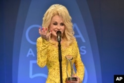 Dolly Parton speaks in the press room after winning the Willie Nelson Lifetime Achievement Award during the 50th annual CMA Awards at the Bridgestone Arena in Nashville, Tennessee, Nov. 2, 2016.