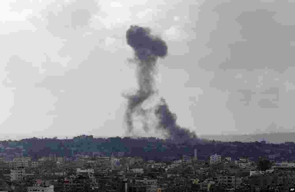 Smoke from an Israeli strike rises over the Gaza Strip, July 25, 2014.