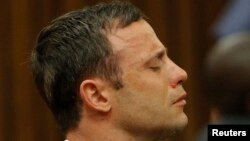 Olympic and Paralympic track star Oscar Pistorius reacts as he listens to Judge Thokozile Masipa's judgement at the North Gauteng High Court in Pretoria, September 11, 2014. A South African judge cleared Oscar Pistorius of all murder charges on Thursday,